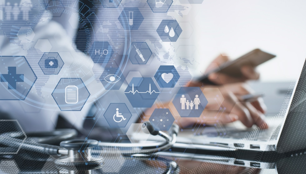 Medical professional at computer with communication graphics overlayed